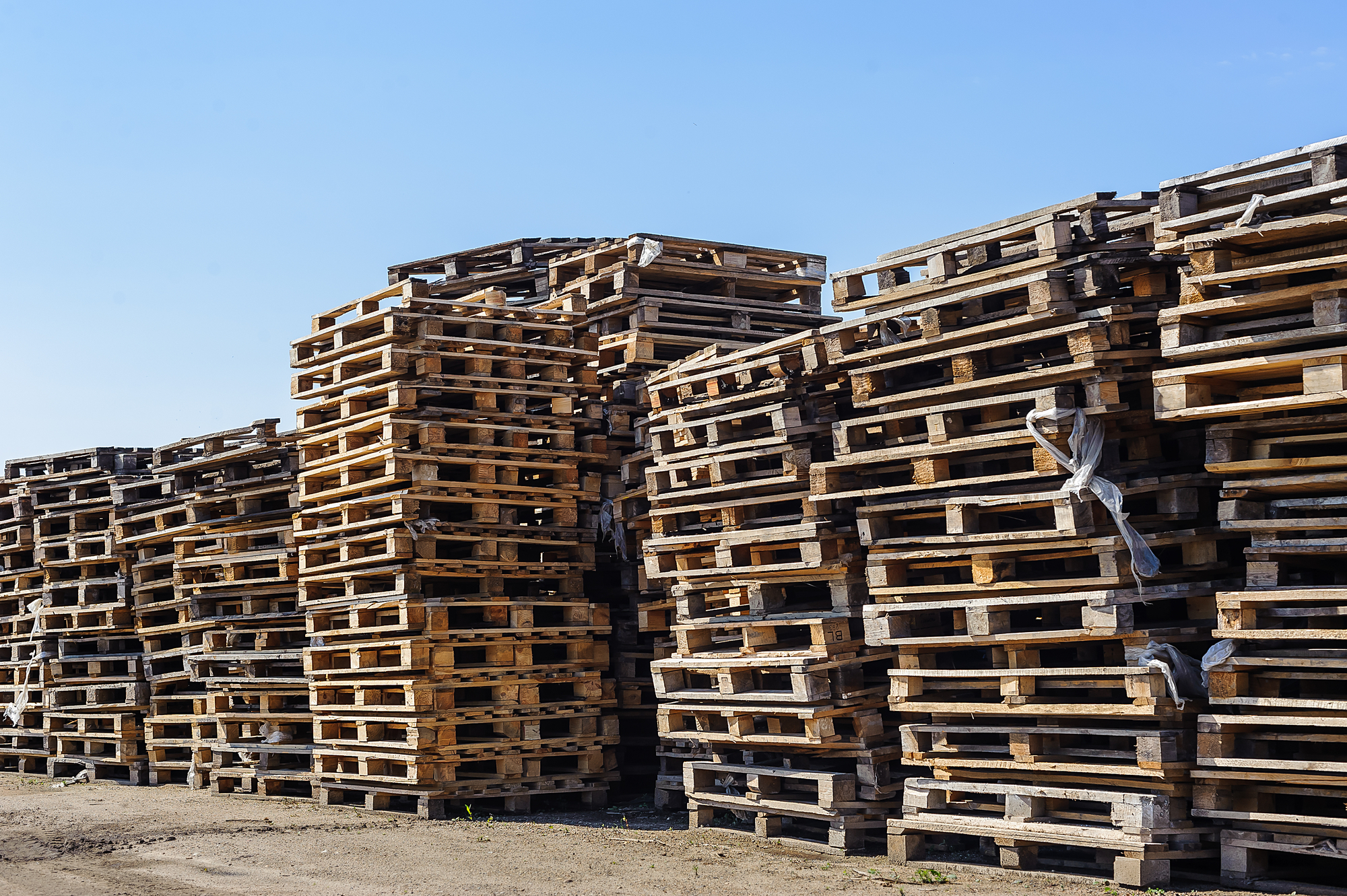 stack of old pallets in need of pallet removal services.