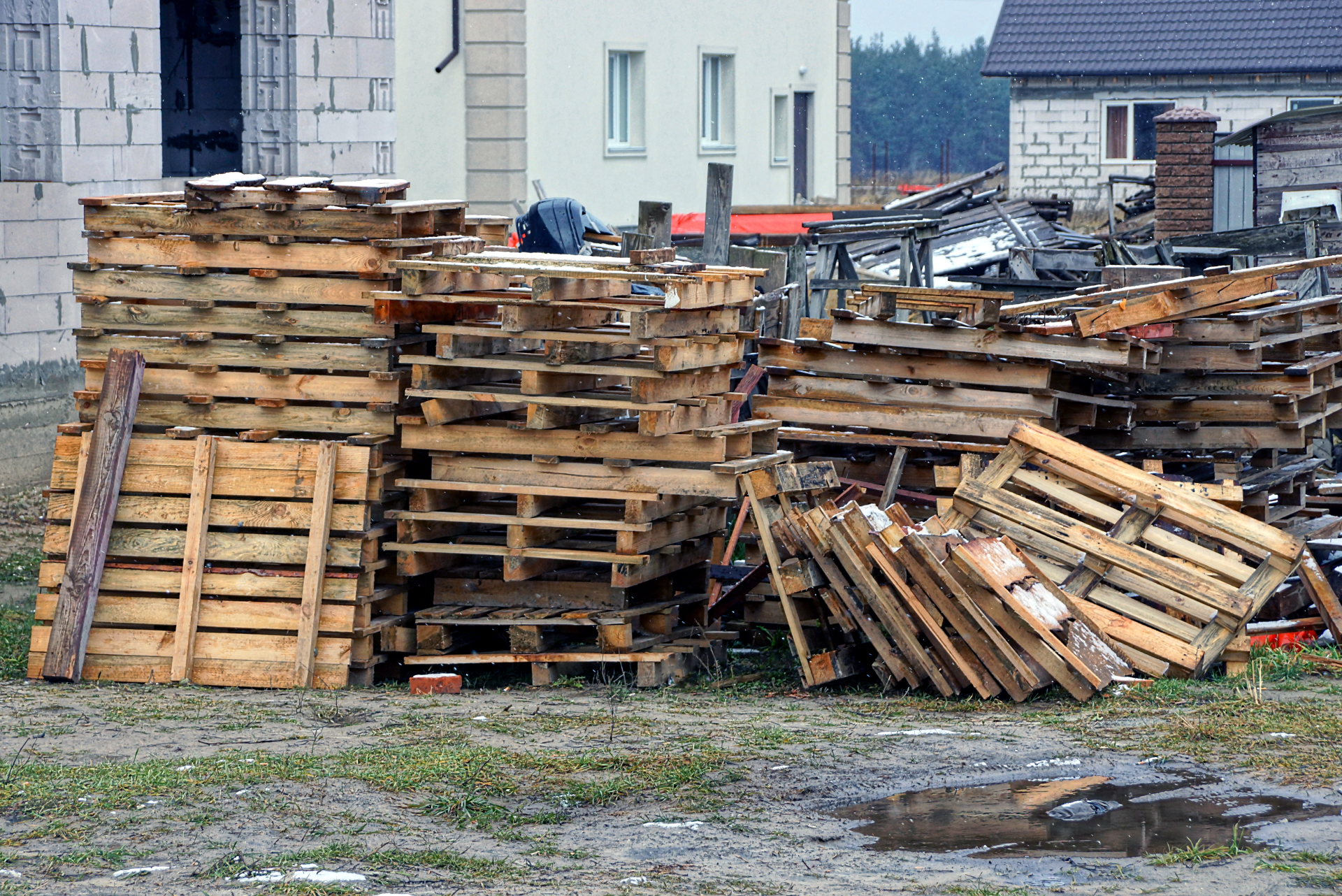 pile of old pallets in need of removal services near me.