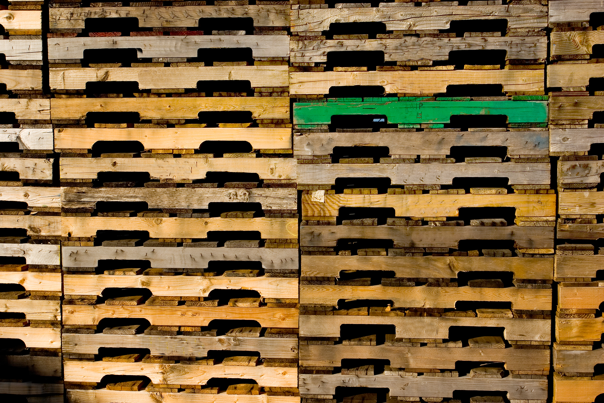 pile of used pallets for sale.